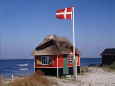 52. Danes express identity through national flags waving from flagpoles