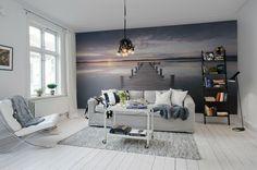 gemütliches Wohnzimmer herrliche Fototapete Blick aufs Meer beim Sonnenaufgang