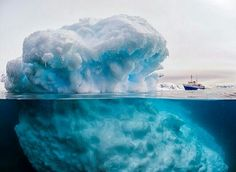 A 'giant' iceberg dwarfs a tonne ship. The photograph is actually an optical illusion, with the block of ice in the foreground only reaching above sea level Cool Pictures, Cool Photos, Paradise Bay, Dramatic Photos, Languedoc Roussillon, Floating In Water, Tonne, Antarctica, Optical Illusions