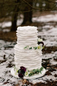 Three Tier ripple Iced Wedding Cake | Winter Bridal Inspiration | Woodland | Stationery By Emma Jo | Flowers By Wild Orchid | Images by Jo Bradbury Wedding Photography | http://www.rockmywedding.co.uk/the-winters-tale/