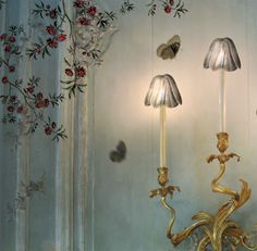 Love the gilded sconces and their cute little shades....most of all the painting on the wall.