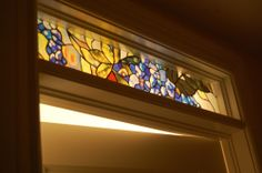 Transom window over a door with stained glass effect