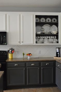 Love the dark back=painted open cabinet, and painted the tile - how cool and enviro-sponsible! (My own made-up term)