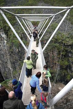 Birtavarre, Norway: The Sabetjohk Pedestrian Bridge a lightweight sandblasted aluminum bridge spans 147 feet across the Gorsa Gorge—northern Europe's deepest canyon. Bridge Structure, Arch Bridge, Pedestrian Bridge, Landscape Architecture Perspective, Bridges Architecture, Norway Design, Steel Bridge, Bridge Construction, Eco City