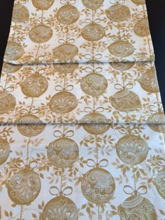 A personal favorite from my Etsy shop https://www.etsy.com/listing/241274247/gold-christmas-table-runner-glisten-gold