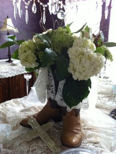 Country wedding...Country bridal shower.  The bride is wearing cowboy boots with her dress...hence the arrangement!!