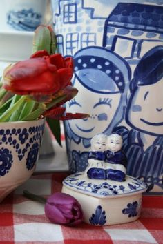 blue pottery and red tulips