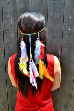 Headband with rainbow colored feathers and beads. Feathers are attached to a chained colorful cotton that can be adjusted to all head sizes with a sliding bead. Item will be shipped 2 - 3 business day