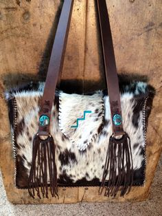 The Buckaroo Tote with custom brand in turquoise suede. From gowestdesigns.us