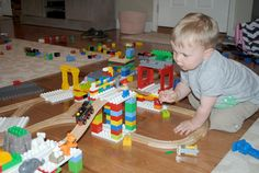 Dreamup Toys bring together building blocks and wooden trains. - they are platforms to make Duplos into train track creations !!