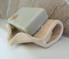 Hand built ceramic self draining soap dish is perfect for your artisanal hand crafted soaps. The dish is angled so that excess moisture from soap