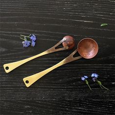 Front and back...hand forged copper and brass spoons - tbs and tsp shown here. Scoop coffee, measure seasonings, dollop some preserves....