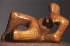HENRY MOORE Reclining Figure, 1936 (elm wood) The synthesis of figure and landscape is one of the major themes of Henry Moore's work. 'Reclining Figure' is also an exemplary illustration of 'truth to materials'. Its skillful carving and polish Abstract Sculpture, Wood Sculpture, Bronze Sculpture, Metal Sculptures, Henry Moore Reclining Figure, Visual Elements Of Art, Henry Moore Sculptures, Contour Drawing, Kinetic Art