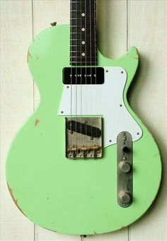 Lime green Les Paul Junior-style electric guitar with tele-style bridge