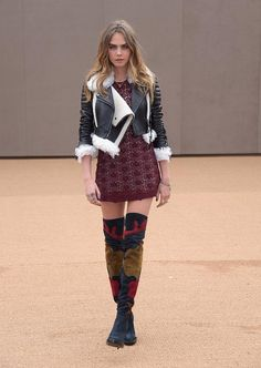 Cara Delevingne offset her lace dress and cropped shearling with patchwork over-the-knee suede boots adding a bohemian element to her luxe look