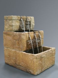 "Gorgeous and durable, the Stone Courtyard Cascade Wall Garden Water Fountain is an exquisite cast stone wall water feature. Standing at 38"" tall, the fountain features three glittering tiers of cascad"