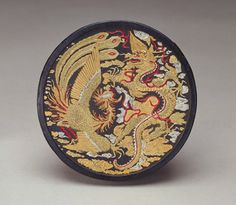 Moulded Round Ink Disk with design of Dragon and Phoenix | 17th century or later | Cheng Junfang (Chinese, 17th century) | Late Ming or Qing dynasty | Soot, animal glue, gold, silver, and red pigments | China | Anonymous gift | Arthur M. Sackler Gallery | S1992.5a-b