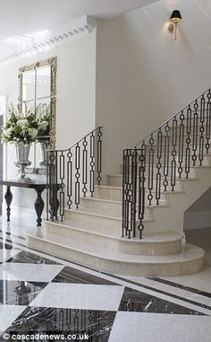 The winding staircase leads you up to the house's eight bedrooms