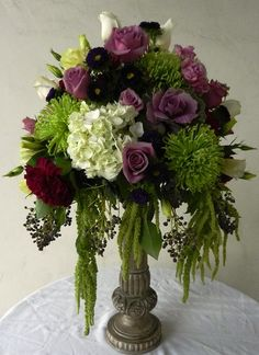 Dramatic Centerpiece of Hydrangea, Dahlia, Rose and Green Fuji Mums with Ornamental Kale and draping Amaranthus
