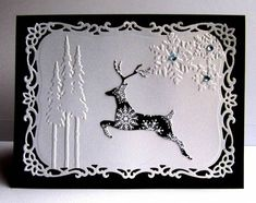 Winter card in black and white with die cuts and embossing...snowflakes, redwood trees and a deer...