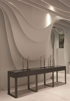 Boutique Runway by CLS Architetti - Dezeen Wall Panel Design, Wall Decor Design, 3d Wall Decor, Contemporary Interior Design, Modern Design, Estilo High Tech, Futuristic Interior, False Ceiling Design, Healthcare Design