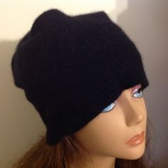 A personal favorite from my Etsy shop https://www.etsy.com/listing/255744945/unisex-black-cashmere-hat-felted