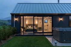 Invercargill House / Mason & Wales Architects need to check out what roof is made of! Also like grey wood, think we would go horizontal though Roof Cladding, Cladding Systems, Timber Cladding, Modern Barn House, Modern House Plans, Modern House Design, Alpine House, Roof Colors, Colours
