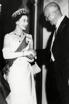 An early sight of Queen Victoria's Garter Badge: October 1957 Queen Elizabeth II welcoming US President Dwight Eisenhower to the British Embassy in Washington
