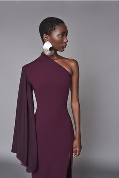 Solace London Lani Dress Aubergine from Fall Winter One shoulder gown falling to floor length, with exaggerated contrast flared sleeve and high split detail. Aubergine medium weight crepe with satin sleeve Exaggerated flared sleeve with pleat det Look Fashion, High Fashion, Womens Fashion, Fashion Design, Fashion Beauty, Madame, Beautiful Gowns, Classy Outfits, Pretty Dresses