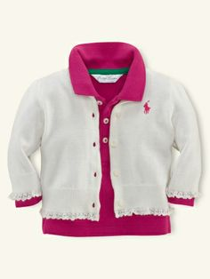 Pretty ruffles accent this classic flat-knit Ralph Lauren cardigan, which is made from soft cotton.