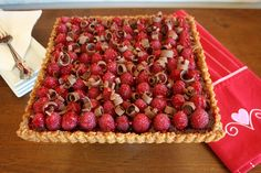 Raspberries and Chocolate Tarts with Pecan Crust on http://www.angiessouthernkitchen.com