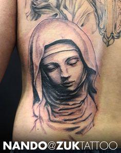 Espalda en proceso con una Virgen.