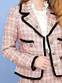 Prep school days reminiscence in this pink tweed blazer featuring contrasting black fringe and gold buttons. Pair it with the Horowitz Tweed Skirt to perfect...