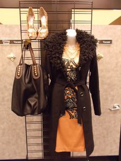 We love this beautiful black Michael Kors wool coat (with removable fur collar) paired with a sophisticated pink New York and Company dress and Jessica Simpson heels. At Clothes Mentor-Alliance Center