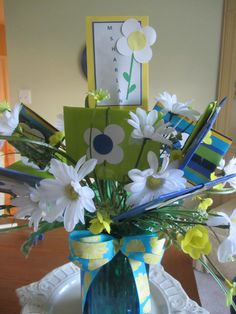 Teacher's end of the year gift card bouquet. Wrapped each gift card in coordinating wrapping paper of school colors and made paper flowers and glued them to each gift card. Put them in a vase with matching colors.