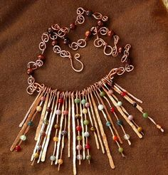 Copper waterfall necklace ( don't love the aesthetic but do love how the beads are trapped with the flattened copper.)