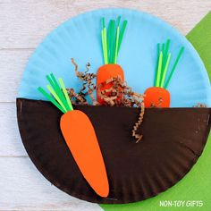 Carrots in the garden craft for kids. Easy paper plate spring craft for toddlers and preschoolers. | at Non-Toy Gifts #CampArtAndCraft