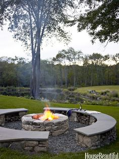 A backyard fire pit designed with storage in mind, speakers are hidden in the walls of local stone, and logs are stacked under the benches. dream-home