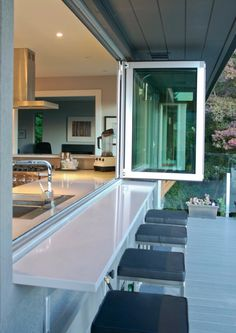 The popular sliding wall restaurant trend has been downsized. Consider adding a sliding window on your next residential home improvement project.