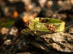 Handmade resin bangles embedded with cedar leaves and tiny pinecones! So me.
