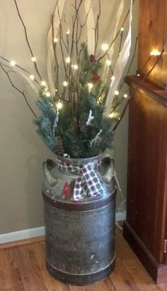 Old Milk Can- Re-do for Christmas with berries and a red ribbon