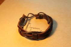 Men's Braided Leather Bracelet wrapped by versionbracelet on Etsy, $3.99 Mens Braids, Braided Leather, Group, Reading, Trending Outfits, Unique Jewelry, Bracelets, Handmade Gifts, Books