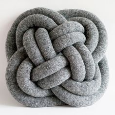 Turk's Head Notknot pillow in heathered grey by Umemi on Etsy, $159.00 These pillows come in different colors and patterns. So fun, but expensive.