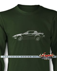 Triumph TR7 Coupe - Lights of Art Long Sleeves T-Shirt - A game of subtle lights and shadows reveal the magnificent curves of the body of this Legendary Coupe. Detailed and harmonious, the illustration has grabbed the essence of one of the most influential vehicle of the 20th century. A true Legend that lives forever: the Triumph TR7 Coupe Long Sleeves T-Shirt!