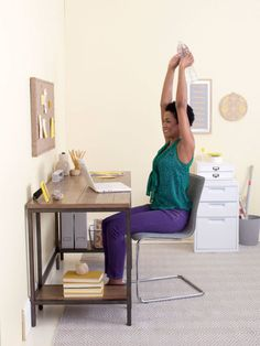 Lazy Woman's Fitness Guide Sit up straight in a chair with your feet flat, and hold a water bottle or another heavy object (the heavier the better) in both hands, arms extended overhead, as shown.