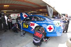 The 3M Pitbulls prep the No. 16 Red Cross Ford in the Sprint Cup garage.   Many members of the crew are blood donors and have the chance to give blood at Roush Fenway Racing-sponsored blood drives.   Credit: Action Sports Photography