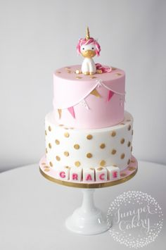 Two-tier christening cake with fondant, cute unicorn figure, cubes with the name of the baby Fondant Toppers, Fondant Cupcakes, Cupcake Cakes, Christening Cake Girls, Mug Cakes, Rhubarb Cake, Elephant Cakes, Girl Cakes, Fancy Cakes