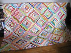 scrappy patchwork hybrid finished. by { philistine made }, via Flickr.  Pattern is Bonnie Hunter's Scrappy Trips Around the World