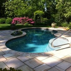 traditional pool by Craig Design Group, Inc