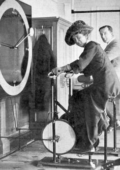 Prior to setting off from Southampton, second-class passengers were allowed to tour the first-class public areas aboard Titanic. Pictured here is Lawrence Beesley and a female passenger, trying out the stationary bicycles in the Gymnasium.